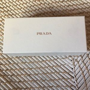 Brand new Prada swirl arm Sunglasses
